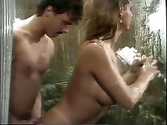 Classic busty porn goddess deep-throats huge cock in the shower then boinks