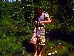 Retro - Woman milks outdoor