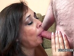 Busty housewife Alesia Pleasure is swallowing a stiff beefstick