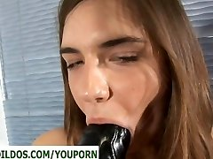 Teen with a monstrous black brutal dildo