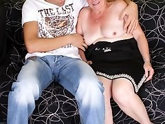 Pretty red-haired Simone uses her long years of experience to seduce a younger guy into hook-up