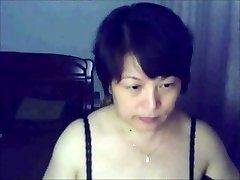 Dame chinois sur webcam
