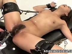 Strapped Asian treats sex machines like a trooper