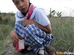 Filipina schoolgirl pummeled outdoors in open field by tourist