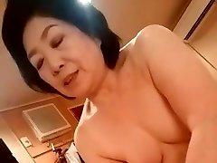 Asian granny give the handjob