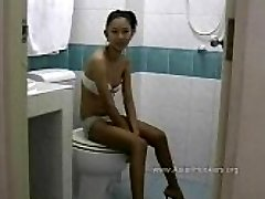 Thai Call Girl Sucks Cock in the Toilet