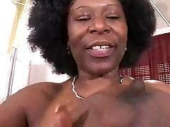 Busty African Mature Has Fat Hooters!!