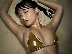 Asian Honey At The Beach In A Bikini Softcore