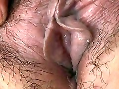 Japanese Granny shows Tits and Labia