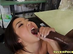 Asian tiny babe sucking on two BBCs in trio
