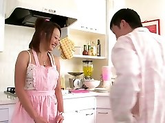 Cute Asian babe loves to inhale cock in the kitchen