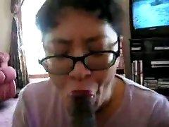 Asian Milf suck black lollipop many times