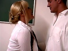 Mature blond with enormous breasts screwed by student in the classroom