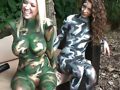Four nasty lesbians with painted bodies play paintball
