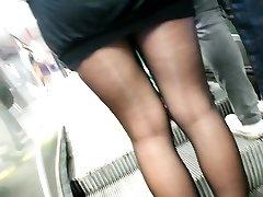Sheer black stockings and short skirt.