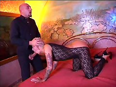 Tattooed slut gets fucked by hung bald guy on bed