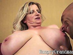 Busty chubby grandma playing