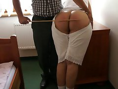 Amelia in the old-fashioned lingerie got caning