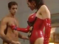Busty latex milf gives the boys a good time