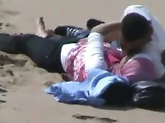 arab hijab girl with her bf caught having sex on the beach