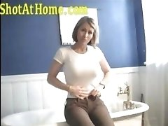 Blonde mommy is posing and caressing her pussy on homemade video