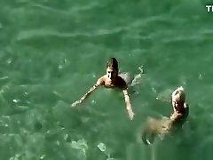 Nudists swimming in the beach