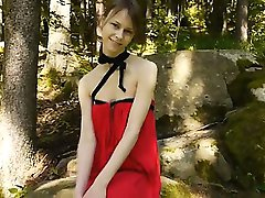 Glass toy in her girly pussy in forest