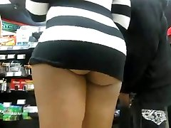 latinna ass upskirt in a public shop