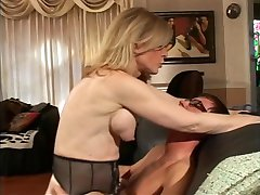 Blonde MILF strips for young dude who sucks her hard nipples