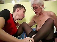 Mature with Silver Hair Glasses and Stocking Wakes the Guy