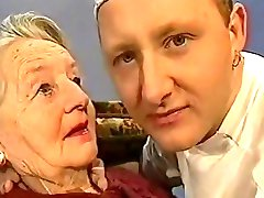 Very old lady gets kissed