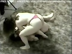Lesbian girls have a raunchy catfight on the carpet