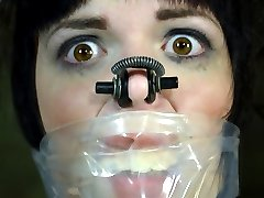 Gagged, blindfolded, with her hands tied behind her back, Madisin Moon waits for PD to come punish her. He whips her cunt until she is wet.