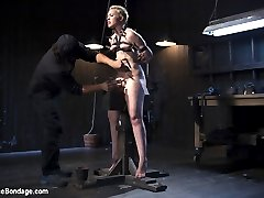 Start by taking a willing pain slut. Add in brutal device bondage, then a heavy helping of torment. Sprinkle on some screaming orgasms, and you have an amazing shoot. Make the bondage more excruciating as the day goes on, and keep adding a variety of pain and suffering. Throw in a splash of dunking while she's blindfolded, and you end up with one of the toughest shoots Elizabeth has ever had to endure.
