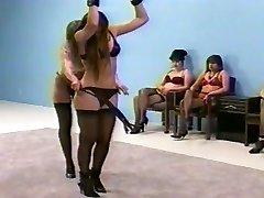 female dom whipping in lingerie (bra and fullback pantys)