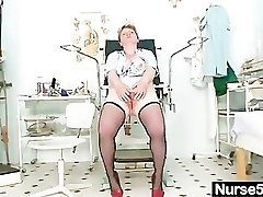 Filthy mature lady toys her hairy pussy with cork