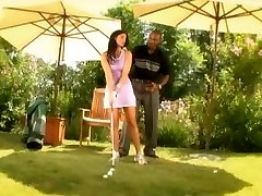 Dark-hued golf teacher tearing up a girl outdoor
