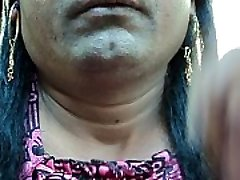 Indian girl pruning her armpits hair by a sharp edged straight razor sleek and clean ..AVI