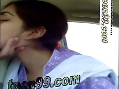 Indian couple kissing hard in the car