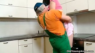 Mouth-watering black-haired teen in stocking sedused by an old plumber on the kitchen