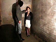 Brunette captive degrades herself to please her two unforgiving captors
