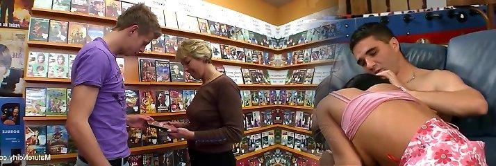 Fabulous blonde mature fucks him in the movie store
