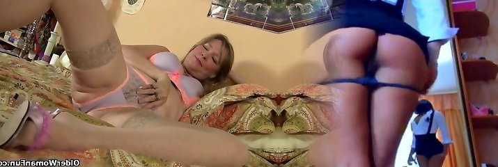 Mature milf pounds herself with a dildo