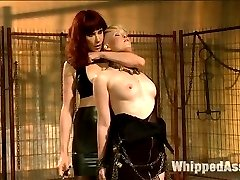 Sasha Knox returns to Kink.com hotter than ever! Sasha, s true submissive who enjoys pushing her limits and submitting to women desperately wants to please Maitresse Madeline as Madeline dishes out her relentless form of domination! Draped in chains she's spanked and flogged so hard she has uncontrollable orgasms just from being hit! She's made to worship Madeline's leather boots and feet while having her nipples tortured and cumming all at the same time. She's bound in tough bondage and cat'o nine whipped while having four fingers stuffed in her cunt then pushed face down on the ground and strap-on ass fucked deep like a filthy whore on the dirty floor!