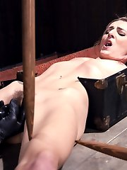 Natasha is not only into being tormented, but she actually makes it a sexual experience. She finds pleasure in suffering. The pain makes her smile and the bondage makes it even better. She begins with her torso locked in a foot locker and her lower half is fully exposed with wooden stakes holding her in place. Next we have Natasha in a kneeling position, her arms in a grueling strappado, her neck in in a steel collar that is bolted to a wooden post, and her legs spread. We get to see exactly how much pain she can endure and keep that smirk on her face. She screams in agony from the torment, and her pussy gushes when the vibe is applied.Finally she is on her back with her arms and legs pulled up leaving her completely helpless and vulnerable. Her feet are destroyed with brutal bastinado before her pussy is ravished and she is made to orgasm uncontrollably.