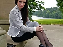 Jaw-dropping dark haired Sophia gets out the office to walk and tease outdoors in nylon stockings and high stiletto high-heeled slippers