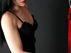 Mistress O is an expert at impact play.  It doesn't matter if it's a whip, cane, paddle, or her bare hands, Mistress O knows exactly how to work a slave.  She takes her slave through a painful session with various implements, and pushes his limits.