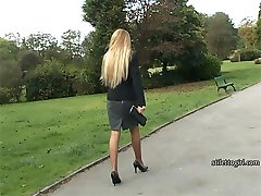Hot blonde babe Claire walks up and down the paths tapping and clacking her sexy high heels,...