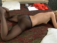 Hottie fondles every toe of her feet before putting on her dark pantyhose
