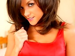 Aimee Luis flaunts her sensational body in her pleated black miniskirt and tight red top.